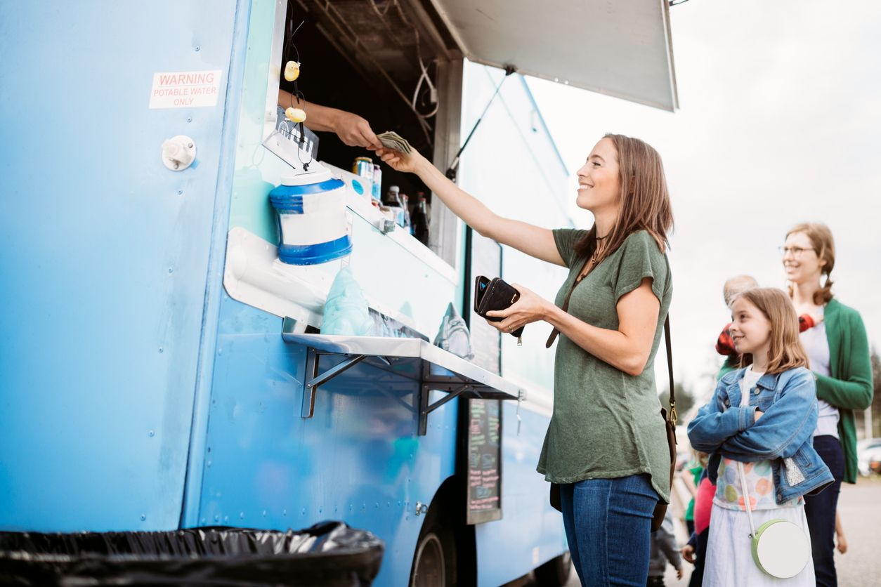 PointofSale woman purchasing food at food truck food truck pos system