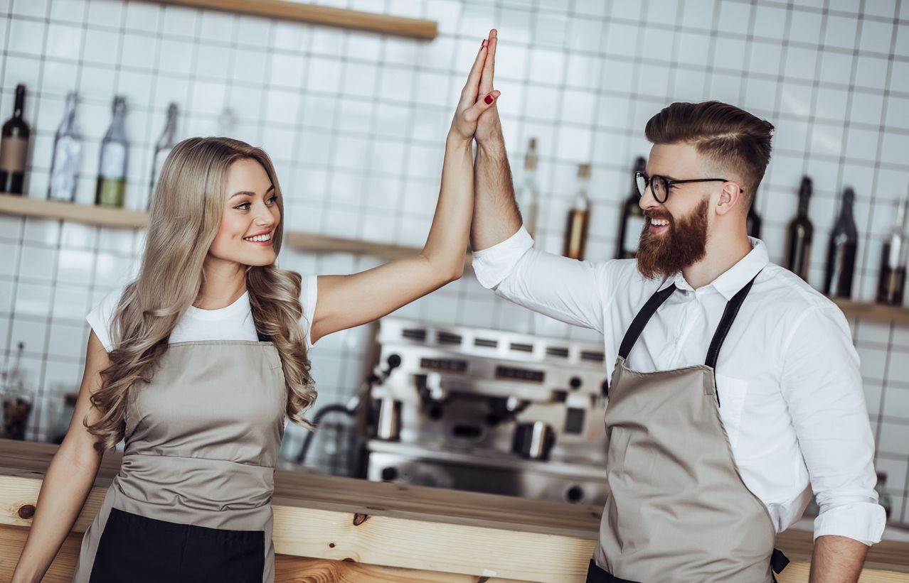 PointofSale Employees high fiving each other How to keep employees motivated